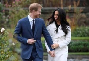 FILE PHOTO: Britain's Prince Harry poses with Meghan Markle in the Sunken Garden of Kensington Palace, London